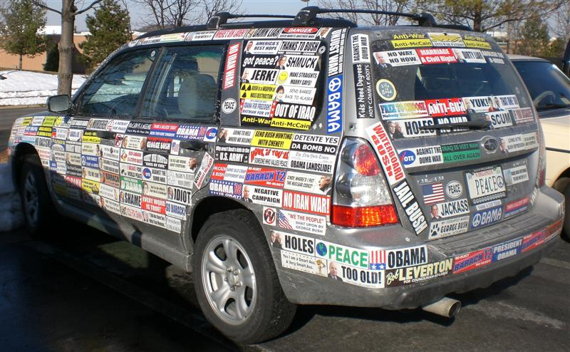 a car covered in bulk with custom bumperstickers