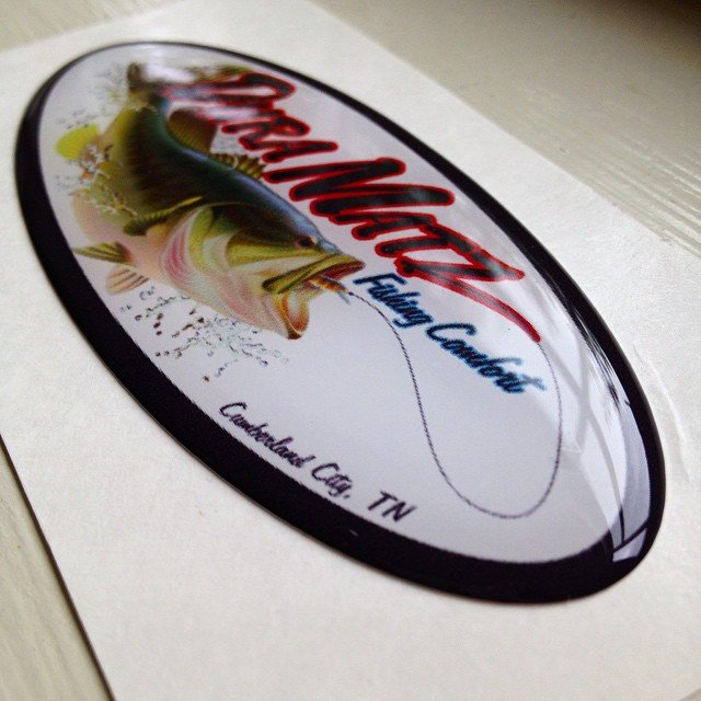 custom oval sticker with poured epoxy domed coating made by websticker