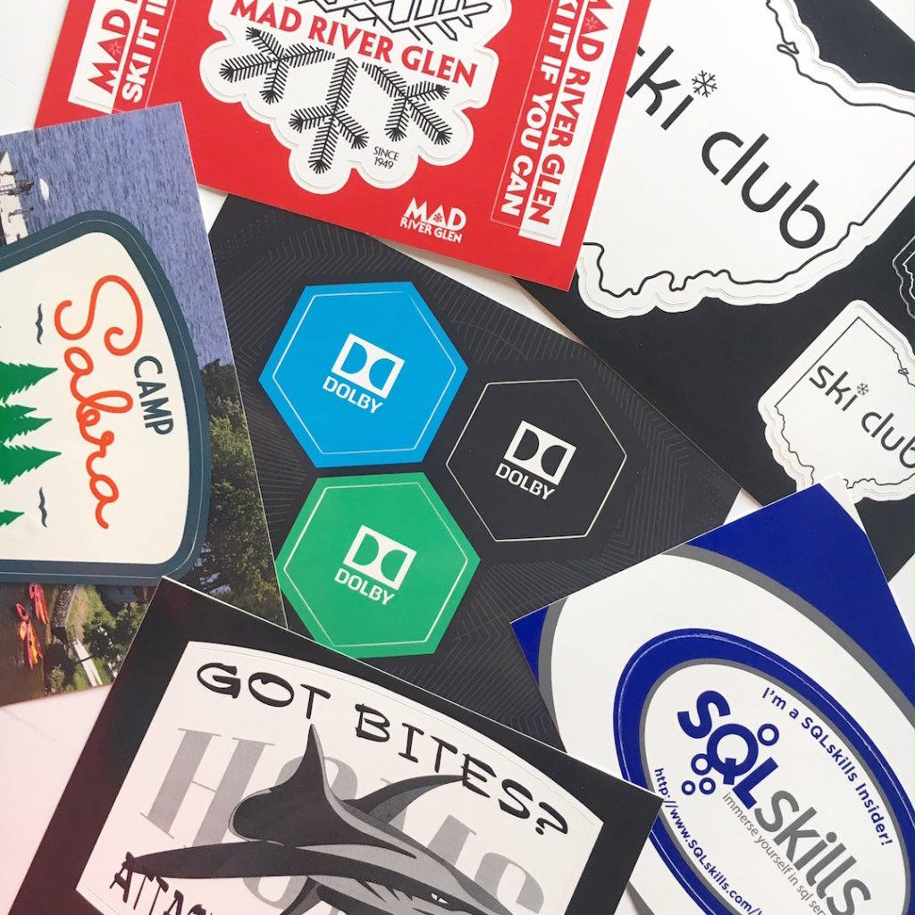 sampling of custom postcard stickers and sticker sheets printed by websticker