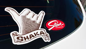 Vinyl Stowe sticker and Shaka sticker on car window