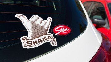 A Shaka sticker and a Stowe sticker on a car, custom made by Websticker