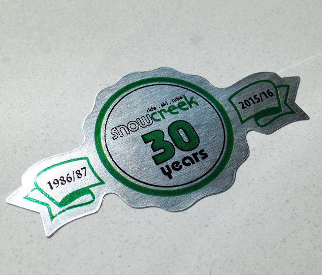 die cut special anniversary label printed on silver foil