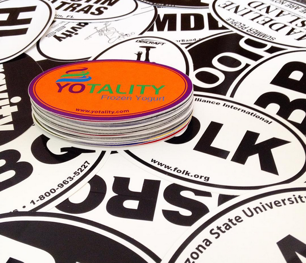 stack of oval, vinyl, screen printed stickers custom printed by Websticker