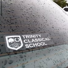 Image of Trinity Classical School window decal showing need for white ink