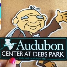 Ned, Websticker's Director of Goodwill poses with a new sticker for the Audubon Center at Debs Park