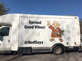 Spread Good Vibes, big Ned sticker on truck going across U.S.