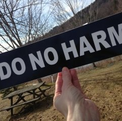 """A bumper sticker reminding us to """"do no harm"""". Keep promotional stickers small and friendly."""