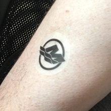 Sample of temporary body tattoo stuck to an arm